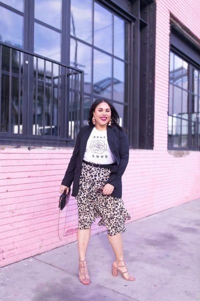 leopard print skirt, graphic tee, black blazer, pink wall