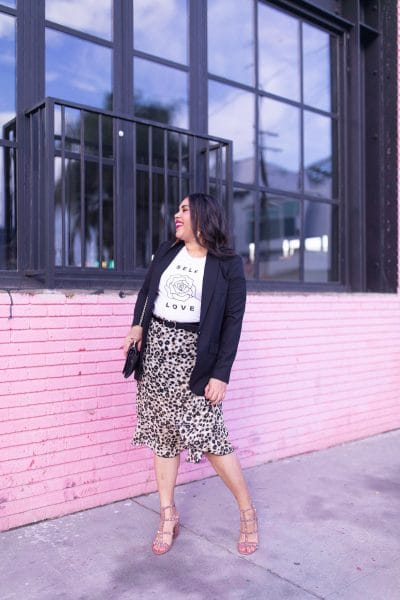 leopard print skirt, graphic tee, black blazer, pink wall, fashion trends