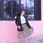 leopard print skirt, graphic tee, black blazer, pink wall