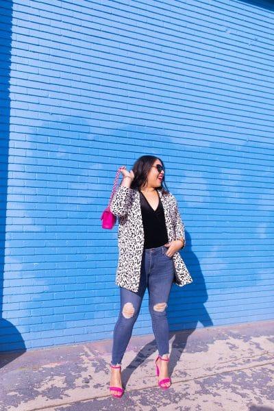 leopard print coat, black bodysuit, midrise jeans, pink heels