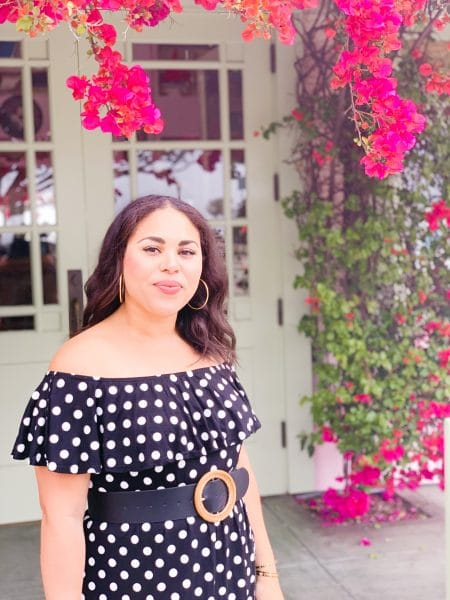 black polka dot dress with pink wedges and rattan accessories